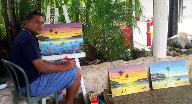 Timoci Sokoiwasa with his paintings at Shangri-La's Fijian Resort. Photo: Charles Chambers